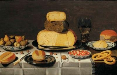 A breakfast piece with cheese, bread, fruit and roemer, on a partially draped table